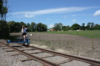 Riding the old train tracks near Lund in Sweden