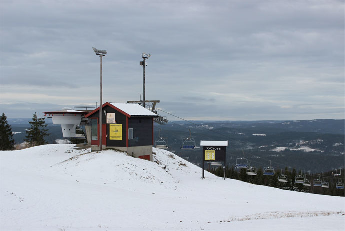 Ski lift at Oslo Winter Park looking out over the hills of Nordmarka