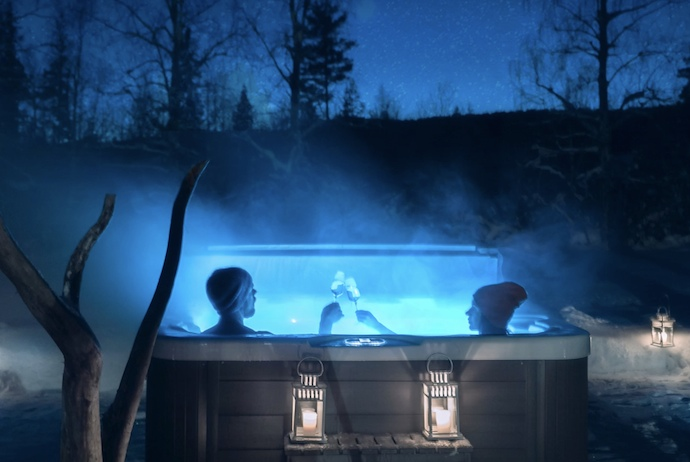 Nothing beats an outdoor hot hut at night at an Arctic spa